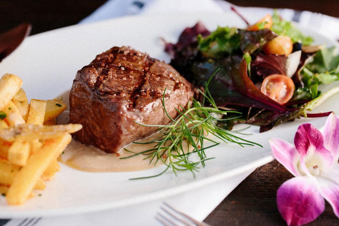 steak, fries, and salad dinner plate